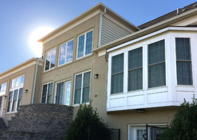 Exterior of residential building with windows tinted by Sunshine Control